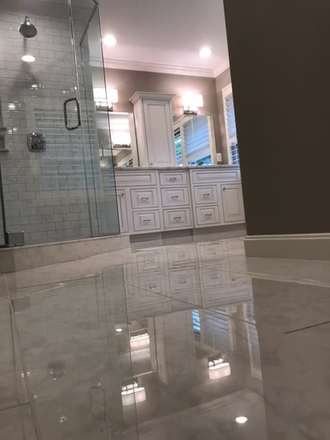 New bathroom tile and mirror installed by Menkat Design and Construction